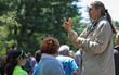 Sign language interpreter Eileen DeToma, standing, signs for the crowd of walkers at the 8th annual Westchester/Rockland Walk4Hearing, May 17 at FDR State Park.