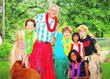 Left to right:  Luau-bound host family Wendy and Greg Nyhus, with their children Aiden, Sukanya and Carter; Ayusa student Vishrutha from India is in the front, kneeling