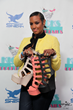 Jackie Christie shows off her signature Dunes-15 wegdes from Shiekh Shoes at theHollywood store grand opening on Saturday, April 26, 2014.