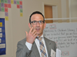 Joel Zarrow, Ph.D., addresses more than 100 business leaders, education advocates and community members at the recent welcome reception hosted by Children's Literacy Initiative (CLI), a non-profit org