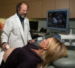 Mike Vlastos, MD performs at ultrasound at the SSM St. Louis Fetal Care Institute.