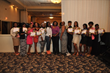 The Chester Community Charter School (CCCS) cheerleading team, and its faculty-member coaches (center), pose with recently awarded trophies and certificates of achievement at the school's Eighth Annua