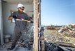 Cody Wright, Army National Guard, helps Team Rubicon demo a home in Vilonia, Ark. Photo by Kirk Jackson.