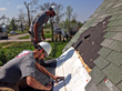Team Rubicon volunteers Marshall Cloud and Michael Selivanoff help repair a roof in Beaver Crossing, Neb.