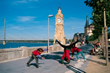 Cartwheeling kids on in Düsseldorf's Rhine River Promenade