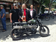"Bryan H. Carroll (center) holding the Quail Ride ""Most Unique"" trophy with the founders of British Customs."