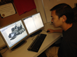 Rocklin High School student Paulo Buencamino reviews a lunabotics design.
