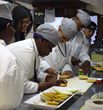 Culinary students try their hand at fruit carving