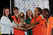 World Team celebrate with the women's trophy.