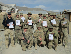 Soldiers deployed in Afghanistan showing Cell Phones For Soldiers calling cards