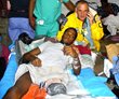 In Port-au-Prince, Haiti, Scientology Volunteer Minister Ayal Lindeman and Ralph Mary Gedeon, waited to board the ambulance flight that would bring Gedeon to the U.S. to save his life.