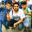 Omar Al-Chaar pictured with two 3rd grade Syrian Students, Amman, Jordan