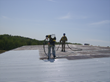 Garland's CPR System is a lightweight, low odour, synthetic liquid rubber membrane designed to extend the service life of existing metal roof and wall panel systems - photo