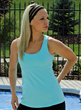 Model Jill Billingsley wearing a light blue tennis top by TerraFrog.