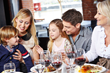 Happy family having dinner together at a restaurant