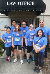 Attorney Elayne M. Perez with her staff outside the office after the run