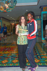 U.S. gold medal Olympian DeDe Trotter (right) proudly displays USA's first Golden Baton, awarded to the best overall team across all ten finals at the IAAF World Relays in Nassau on May 25, with Muna Issa (left), vice president, operations, SuperClubs, at