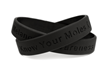 """Know Your Moles' message on a black rubber wristband"