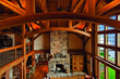 This timber frame home by New Energy Works highlights the uses of reclaimed antique Heart Pine timbers.