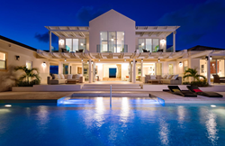 A photograph of Villa Isla villa rental, Turks and Caicos Islands, by night
