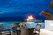 A photograph of the swimming pool and fire pit of Wild Cherry villa rental, Turks and Caicos Islands
