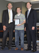 Academy of Model Aeronautics Employee Chris Savage Receives Thomas Office Solutions Office Champion Award