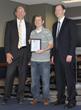 Academy of Model Aeronautics Employee Chris Savage Receives Thomas...