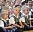 Everest Academy prek students concentrated on the puppet show