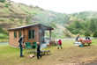 A family enjoys camping at a Romtec cabin.