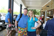 Celebrity golfer Katie McCall with her winning bidder, Davis Dillard