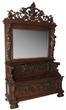 Hall bench: R. J. Horner figural carved oak hall bench, 105 inches tall, having a large pierce-carved crest with center medallion (est. $25,000-$35,000).