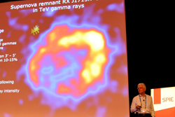 Highlights include daily plenary talks; above, in 2012, Werner Hofmann, Max-Planck-Institut für Kernphysik, described gamma ray detection research by the High-Energy Stereoscopic System (HESS).