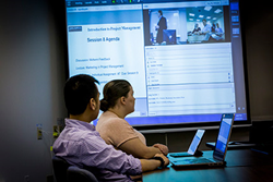 Classroom-based and remote students attend live classes together in a synchronous learning environment.