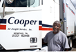 Anthony Walker, driver for Cooper Freight Service stands behind his truck at Cooper's terminal in Grenada, MS.