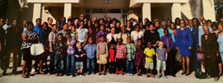 Members of the Faith Deliverance Temple Community pictured in front of the beloved church building.