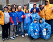 Scientology Volunteer Ministers of Vancouver in their bright yellow jackets were among the volunteers manning water stations May 4, 2014, at the Vancouver Bank of Montreal (BMO) Marathon.