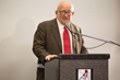 Ed Asner addresses the first Exceptional Minds graduating class Sunday.
