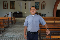 Father Nelson in his church in El Salvador