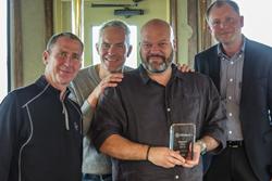 Steve Odart, CEO & cofounder of Ixxus, receiving the Alfresco Partner Awards