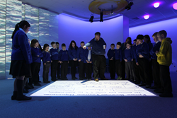 Children learning on an Interactive Floor in an educational Immersive Space