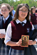 Cassandra displays the Prayer for Life card in commemoration of the visit of Our Lady of Czestochowa to North America