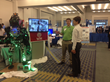 WPI's Atlas team leader Matt DeDonato (left) shows the humanoid robot at today's SmartAmerica Expo in Washington, D.C.