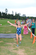 A child experiences a triumphant moment during the Morrison Family YMCA's Kids Tri Ballantyne.