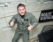 Made In Space CEO Aaron Kemmer during 2013 microgravity tests of the space-bound printer aboard Zero-G Corporation's modified Boeing 727.