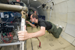 Made In Space Lead Deputy Program Manager Matthew Napoli tests the space-bound printer during a 2013 microgravity flight aboard Zero-G Corporation's modified Boeing 727.