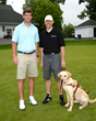 NY Giants Quarterback Eli Manning and Guiding Eyes' president & CEO Thomas Panek (of South Salem) with Guiding Eyes Gus at the 37th annual Guiding Eyes for the Blind Golf Classic.
