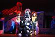 Mr. Mistofalees (Isaac Ryaboy) sits in Bustopher Jones' (Arturo Fernandez) lap while Skimbleshanks (Sebastian Merino-Beattie), Munkustrap (Zachary Dishinger) and Rum Tum Tuger (Jacob Shawwa) sing of t