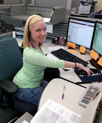 Photo of Kristen Gusmus at her desk