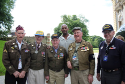Andrews Federal Credit Union's Mikel Russel, HR Generalist poses with several WWII Vets