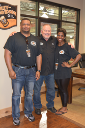 Southern Thunder Harley-Davidson Owner Bob Parsons Pictured with BGCNMS Staff Tonny Oliver and Evie Boyd
